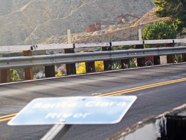 The bent over sign marking the Santa Clara River is seen from near Soledad Canyon Road, east of Santa Clarita.