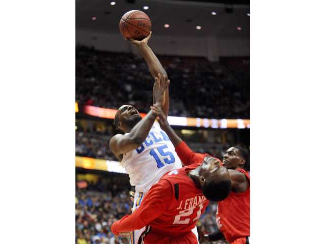 UCLA's Shabazz Muhammad (15) collides with San Diego State guard Jamaal Franklin (21) as he drives to the basket during the John R, Wooden Classic on Saturday in Los Angeles.