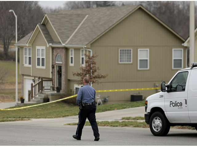 A police officer walks to an Independence, Mo., house where police say Kansas City Chiefs linebacker Jovan Belcher fatally shot his girlfriend.