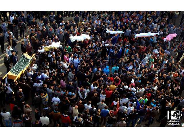 Anti-Syrian regime mourners carry the coffins of Syrian civilian who where killed by the shelling of Syrian forces loyal to president Bashar Assad.