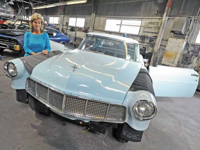Juli Fennel with a 1956 Continental in her late husband Mike Fennel's restoration shop in Saugus. The classic car is one of six that employees are restoring following Mike Fennel's death in September.