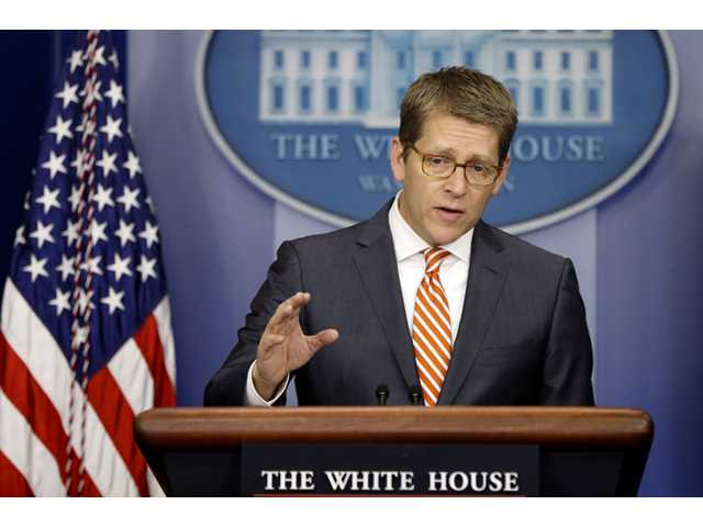 White House Press Secretary Jay Carney gestures as he briefs reporters at the White House in Washington, Tuesday.