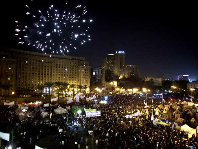 Fireworks burst over Tahrir Square as protesters gather in Cairo, Egypt on Tuesday.