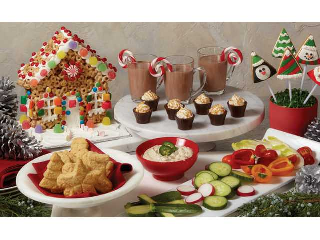 Holiday House Treat, Crispy Cheese Crackers, Eggnog Hot Chocolate, Salted Caramel Bacon Cordial Cups, Fire Roasted Jalapeño Onion Dip, and Gingerpops Cookie Kit are seen above.