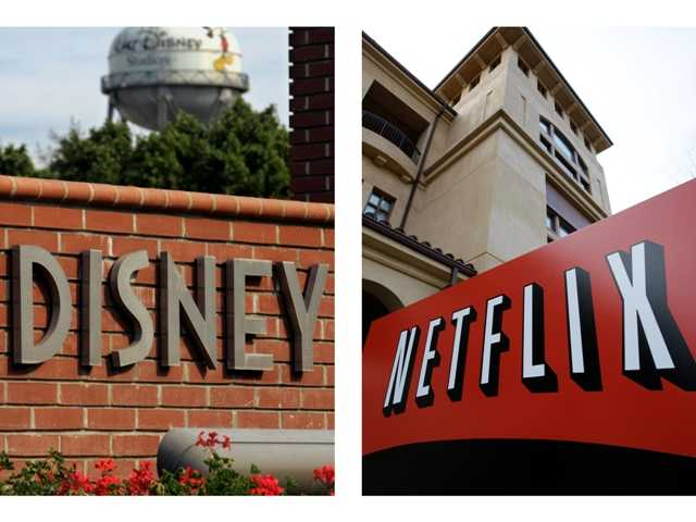 This combination of AP file photos shows the Walt Disney logo in Burbank and Netflix's headquarters in Los Gatos, Calif. Netflix's video subscription service has trumped pay-TV channels and grabbed the rights to Disney movies.