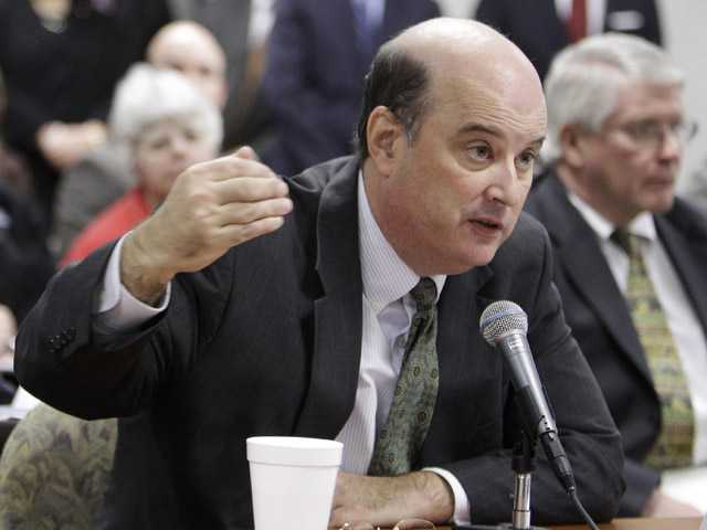In this Nov. 15, 2010 photo, Social Security Commissioner Michael Astrue answers questions in Akron, Ohio.