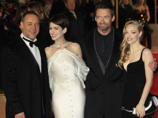 Russell Crowe, Anne Hathaway, Hugh Jackman and Amanda Seyfried arrive on the red carpet for the World Premiere of 'Les Miserables' in Leicester Square, Wednesday.
