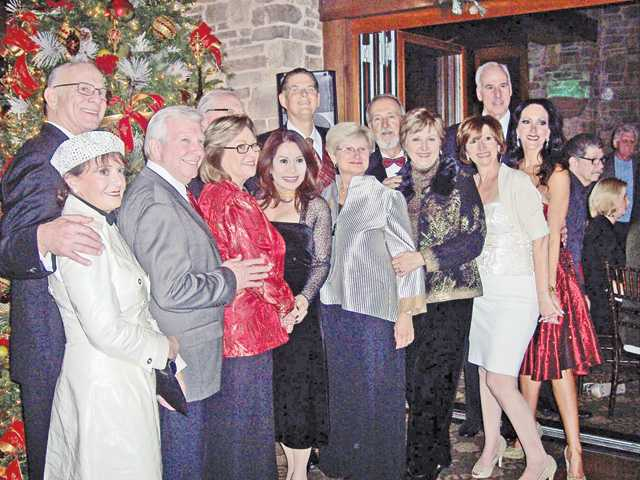 Henry Mayo Newhall Memorial Hospital officials and supporters gather in front of the Christmas Tree at the Tournament Players Club in Valencia on Friday at the special gala preview event.