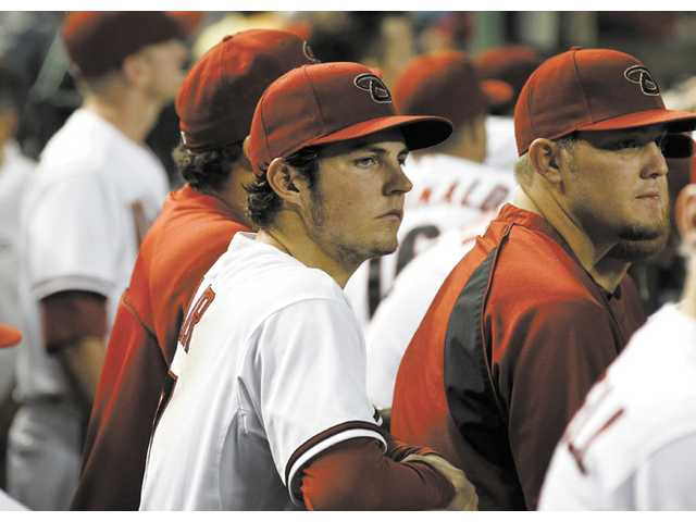 Arizona Diamondbacks pitcher and Hart graduate Trevor Bauer, left, watches the action against the San Diego Padres on July 3 in Phoenix.