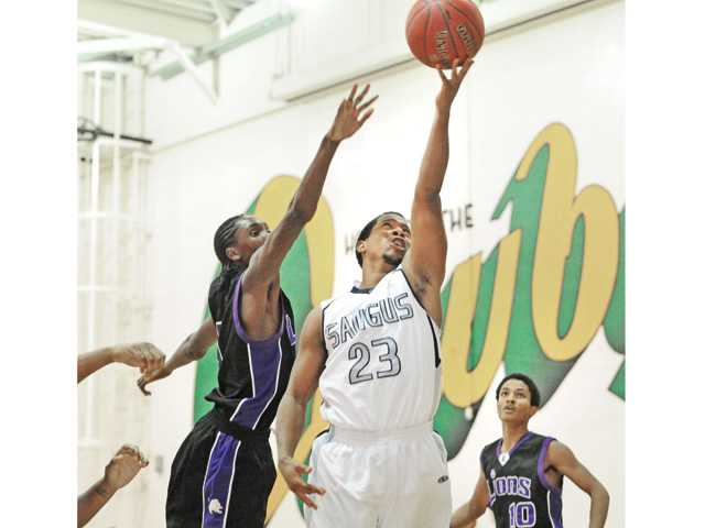 Saugus senior Chris Lockwood (23) goes up for a layup against Eastside on Wednesday at Canyon High.