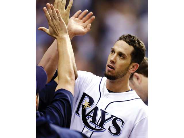 Tampa Bay Rays pitcher and Hart High graduate James Shields high-fives teammates after an Oct. 2 game against the Baltimore Orioles in St. Petersburg, Fla.