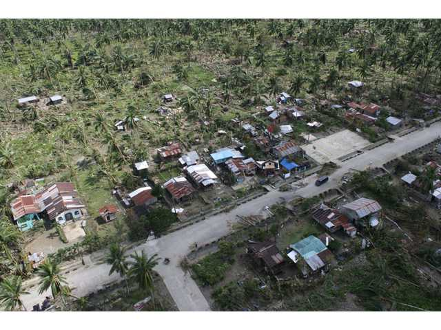 An aerial view of toppled trees and homes caused by flashfloods in Compostela Valley province, southern Philippines on Thursday.