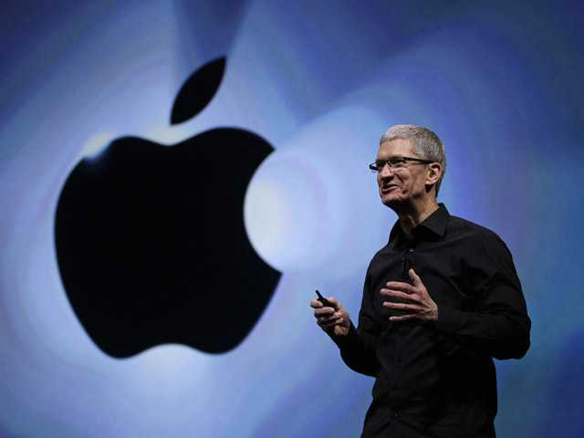 In this Sept. 12, file photo, Apple CEO Tim Cook speaks following an introduction of the new iPhone 5 in San Francisco.
