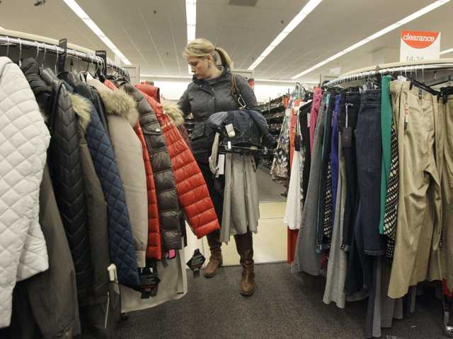 A shopper checks winter jackets in a Nordstrom rack in Chicago, Nov. 1.