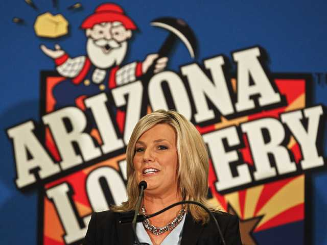In this Nov. 29 photo, Karen Bach announces  in Phoenix that one of the winning tickets in the $579.9 million Powerball jackpot was purchased in Fountain Hills, Ariz.