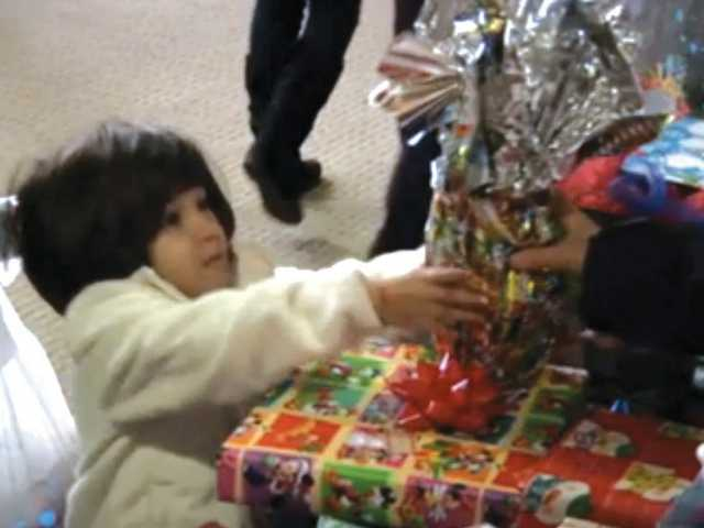 One boy excitedly receives his present at Festividad.