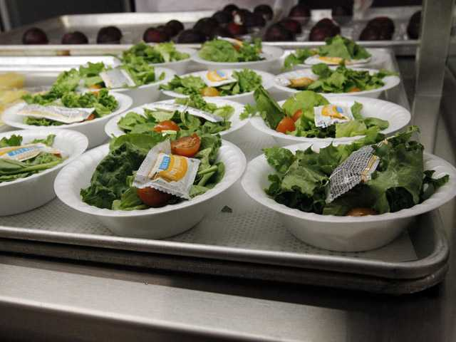 In this Sept. 12,  photo, side salads await the students of Eastside Elementary School in Clinton, Miss.