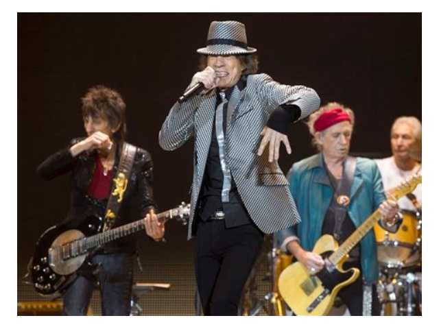 Mick Jagger, center, Keith Richards, Ronnie Wood, left, and Charlie Watts, right, of The Rolling Stones perform at the O2 arena in east London, Sunday, Nov. 25, 2012. The band are playing five shows to celebrate their 50th anniversary, including two shows at London's O2 and three more in New York.