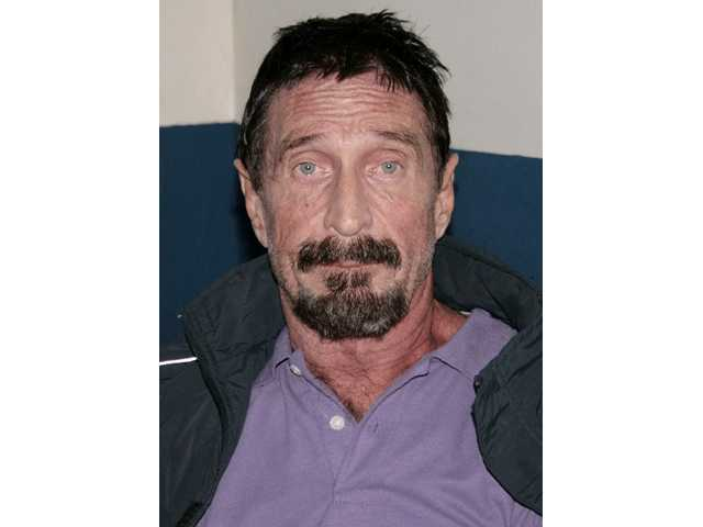 Software company founder John McAfee is photographed in an immigration detention center in Guatemala City.