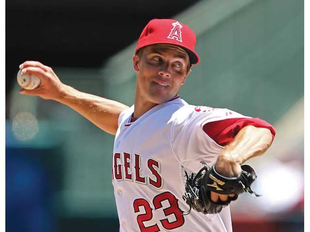 Free agent pitcher Zack Greinke, pictured as a Los Angeles Angel, is reportedly close to a deal with the Los Angeles Dodgers worth $147 million over six years.