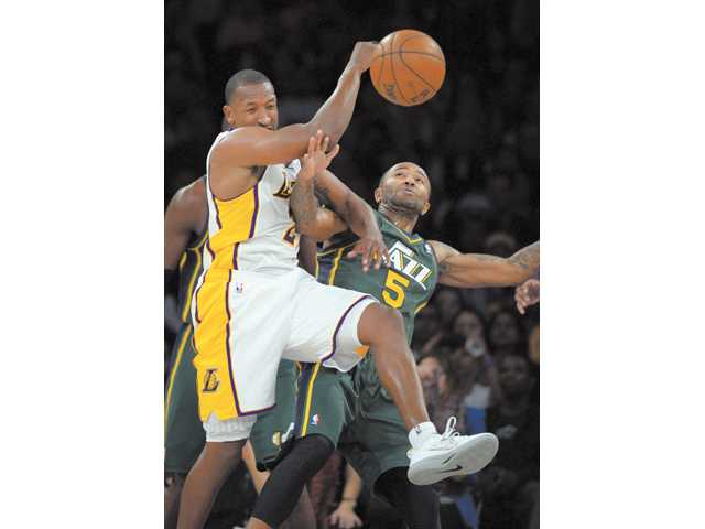 Los Angeles Lakers guard Jodie Meeks, left, and Utah Jazz guard Mo Williams battle for a rebound during the first half on Sunday night in Los Angeles.