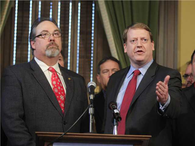 Michigan House Democratic Leader Elect Tim Greimel, right, and current House Democratic Leader Rick Hammel, left, meet with the media, in Lansing, Mich.