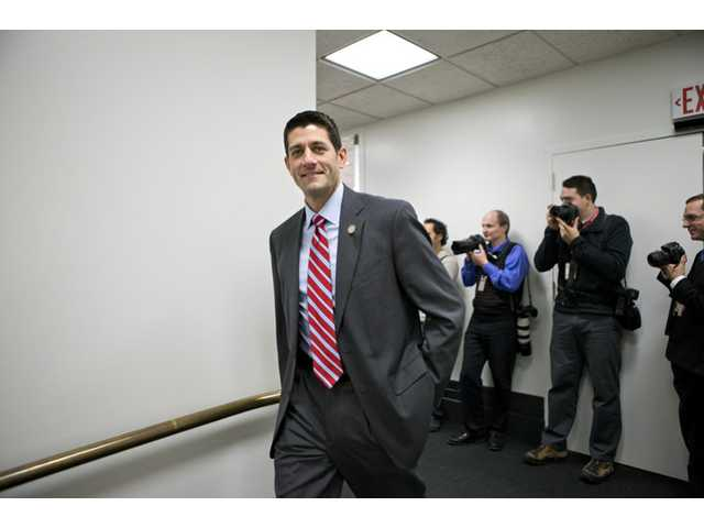 House Budget Committee Chairman Rep. Paul Ryan, R-Wis., the 2012 Republican vice presidential candidate, walks on Capitol Hill in Washington.