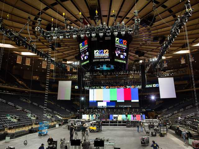 "Workers prepare Madison Square Garden for the ""12-12-12"" concert whose proceeds will aid the victims of Superstorm Sandy, Tuesday."
