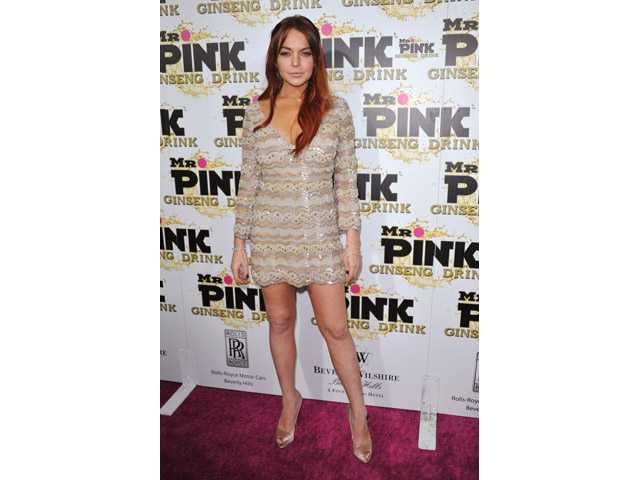 Lindsay Lohan attends the Mr. Pink Ginseng launch party at the Beverly Wilshire hotel in Beverly Hills, Calif.
