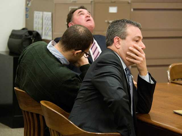 Defense attorneys, Michael Molfetta, background, and Paul Wasserman, foreground, react as guilty verdicts are announced in the retrial of Charles Anthony Murphy Jr., center, on Wednesday in Santa Ana, Calif.