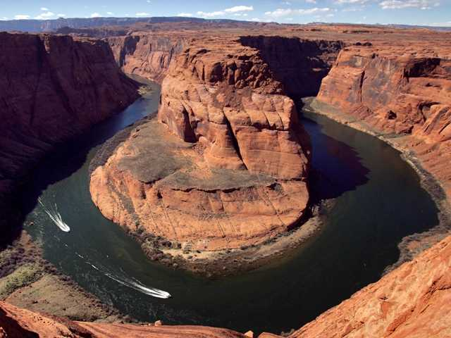 This March 5, 2008 file photo shows the Colorado River's Horseshoe Bend, in Page, Ariz. Rising demand and falling supply is spurring talk about the dependence on water from the river.