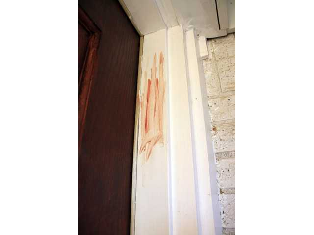 The door frame at a home in Richland Hills, Texas, where a man is accused of using a box cutter to carve a pentagram in his six-year-old son's back.