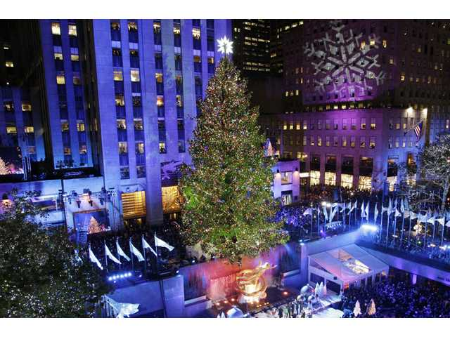 The Rockefeller Center Christmas tree is lit during the 80th annual tree lighting ceremony in New York.