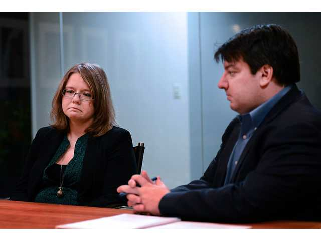 Attorney Mark Chalos, right, sits with Melanie Norwood, left, as they talk about the condition of Norwood's mother, Marjorie Norwood.
