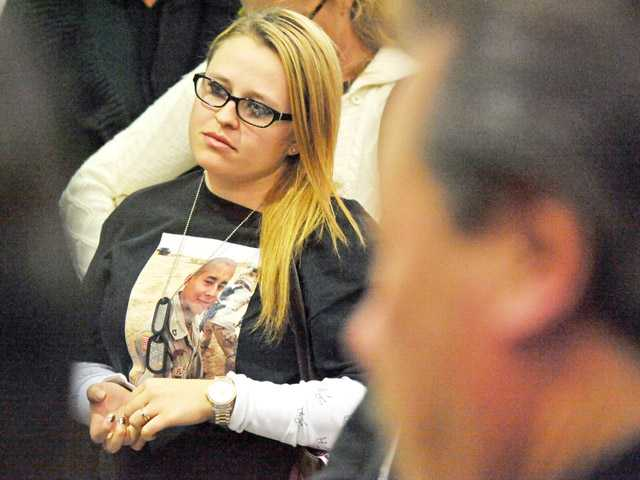 Heather Sandnes, of Valencia, listens to a presentation. Sandnes's brother, Army Pfc. Jose Ricardo Flores-Mejia, died in Iraq in 2004.