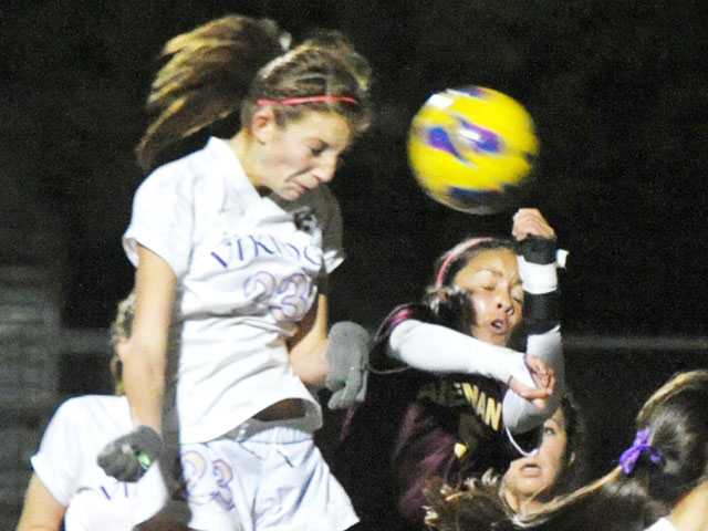 Valencia's Taylor Venegas (23) heads the ball past Alemany's Miriam ramirez (5) to score in the first half at Valencia High on Wednesday.