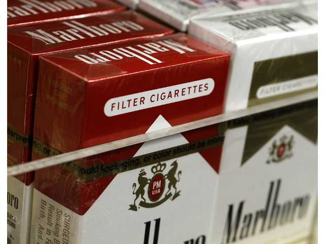 Pictured are packs of cigarettes waiting to be purchased at a Chicago area news stand Friday.