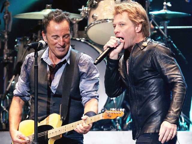 This image released by Starpix shows Bruce Springsteen, left, and Jon Bon Jovi performing at the 12-12-12 The Concert for Sandy Relief at Madison Square Garden in New York on Wednesday.