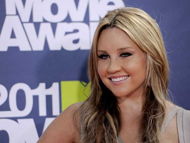 In this June 5, 2011 photo, Amanda Bynes arrives at the MTV Movie Awards, in Los Angeles.
