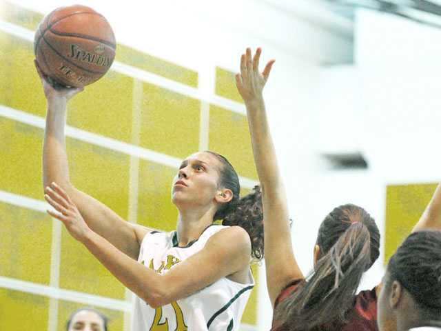 Canyon's Jaya Schultz (21) shoots past Highland's Amber Zamudio (3) on thursday night at Canyon High School.