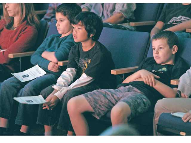 Live Oak Elementary School fourth graders from left, Jake Quintant, Jules Gabumpa and Ethan Coyle watch the ballet.