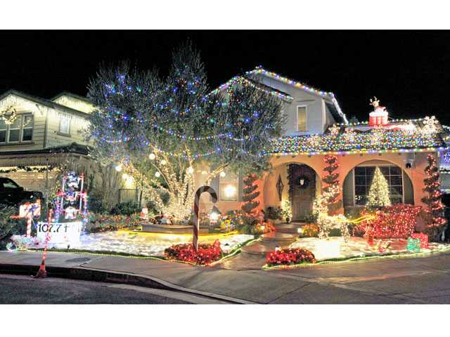 Eli Hallak and family in Stevenson Ranch captured the 2012 SCV World Champion of Lights crown with a majority of the popular vote and judges scores. The elaborately decorated home features 30,000 computerized lights that dance to the music played on 107.7 FM radio.