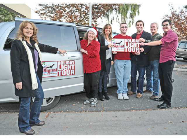 The Signal's Holiday Light Tour judges, left to right, Jana Adkins, Michele E. Buttelman, Alesia Humphries, Jason Schaff, Vince Johnson, Jim Walker and Luke Money.