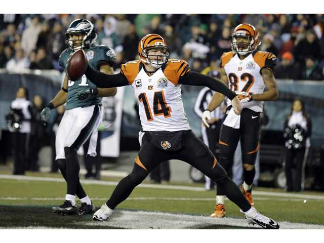Cincinnati Bengals quarterback Andy Dalton (14) spikes the ball after scoring a touchdown against the Philadelphia Eagles on Thursday in Philadelphia.
