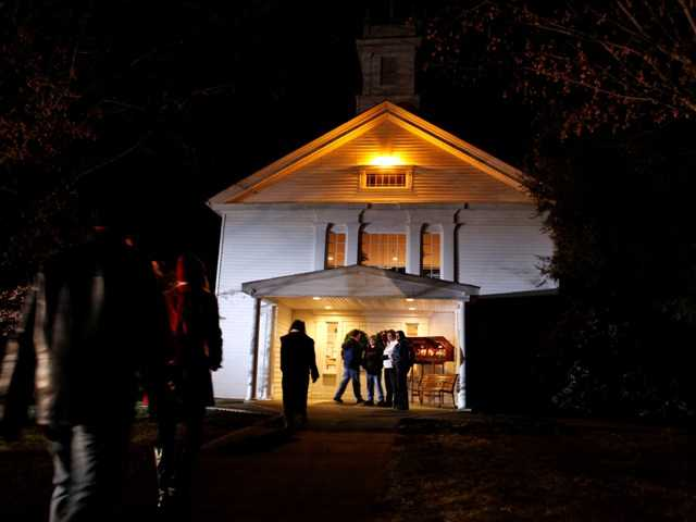 People arrive for a prayer service at Newtown United Methodist Church in the aftermath of a mass shooting at nearby Sandy Hook Elementary School, Friday in Newtown, Conn.