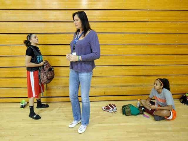Gabrielle Ludwig, a 6-foot-6-inch transsexual player on Mission College's women's basketball squad, speaks with teammate Felicia Anderson, left, after practice on Friday in Santa Clara, Calif.
