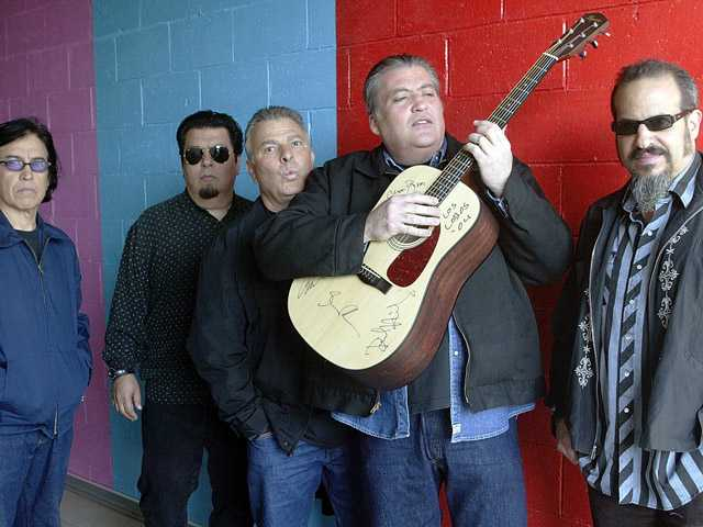 This April 7, 2004, photo shows members of the band Los Lobos posing for a photograph, in Los Angeles.