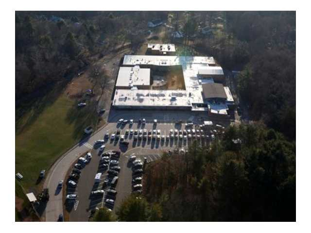 This aerial photo shows Sandy Hook Elementary School in Newtown, Conn. where authorities say a gunman opened fire in a shooting that left 27 people dead, including 20 children, Friday, Dec. 14, 2012.
