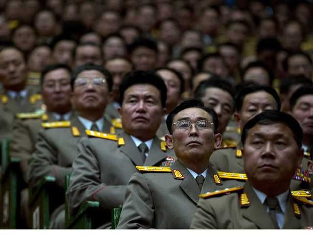 North Korean military officers attend a national meeting on the eve of the first anniversary of the death of Kim Jong Il.
