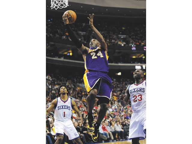 Los Angeles Lakers guard Kobe Bryant (24) shoots on Sunday in Philadelphia.